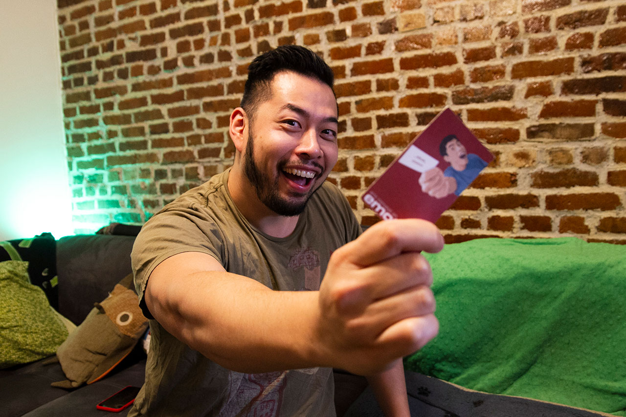 Eric holding the official Emotion Eric business card